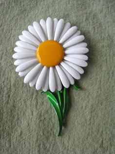 vintage daisy brooch / My hair would get wrapped around it mom would have to cut it off.