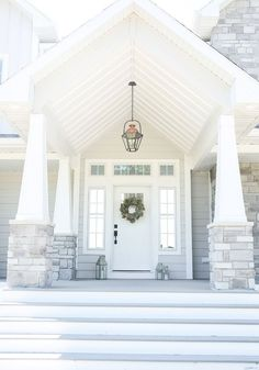 Exterior Lighting. porch Lantern. Porch lantern exterior lighting. Porch Lighting. The exterior light fixture is Pottery Barn Case Oversized Pendant #porchLantern #porchlighting #exteriorlighting Beautiful Homes of Instagram @nc_homedesign via Home Bunch