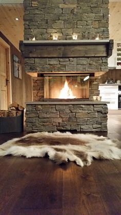 "Enjoy the Visio 3 from almost every side in this Norwegian cabin - it looks like a fireplace in the middle of the house #Rais #Fireplace #Cozy ""Inspiration"