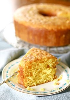 Moist lemon cake recipe made from scratch with a box mix and pudding. This recipe is absolutely amazing and so easy to make! Cake Mix Recipes, Pound Cake Recipes, Frosting Recipes, Dessert Recipes, Lemon Desserts, Lemon Recipes, Best Pound Cake Recipe, Lemon Chiffon Cake, Angel Food Cake Pan