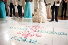 Wedding reception first dance at Biltmore Ballrooms Atlanta. Dance floor custom monogram decal by I Do Linens