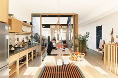 mjolk boutique owners renovate their Toronto dwelling interior kitchen - copper piping chandelier