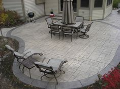 Stamped concrete patio-has the color, pattern and shape I'm looking for.