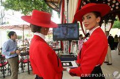 Viernes de Feria en Jerez, Spain - Dos azafata del 'Tío Pepe' en el templete de González Byass en el recinto ferial.
