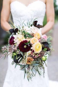 Colorful creams and Marsala bridal bouquet.
