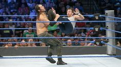 In today's WWE SmackDown Live event, the WWE World Champion, Dean Ambrose gave a tough fight with The Lone Wolf Baron Corbin. Check out HD Photos