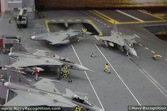 Sea Gripens displayed on a carrier flight deck.