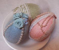Here is another set of Easter Bowl Fillers, introducing the newest line of handmade paper mâché glitter eggs for the Spring Easter Season.  These are approx. 4 inch plus. You recieve this set of 3 pictured here, light blue, pink, and light green. I didn't stop there...I embellished each set with pretty vintage lace, pearls, ribbon, cameo and handmade clay roses. What a fabulous Bowl filler set.  Thank you for looking