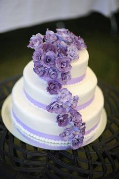 3 tier wedding cake with purple sugar flowers I made