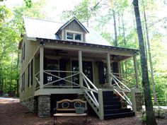 Really cute small house with 1 BR, 1 BA in the loft; add bench seating in left kitchen area; could add an enclosed porch & small apartment off of it (like in the Dog Trot plan) Hatchet Creek 794 sq ft small-guest-house-plan-design