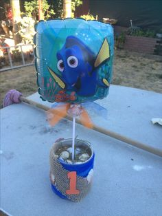 Finding Dory DIY table  centerpieces I made for my sons birthday party out of formula cans.