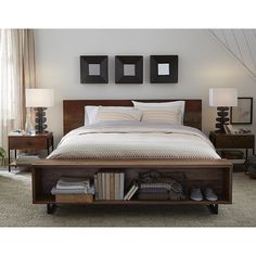 Shop Atwood King Bed with Bookcase.   Atwood king bed's footboard features a built-in, divided bench/bookcase for seating, display and storage.  The Atwood King Bed is a Crate and Barrel exclusive. Learn  with our tips and advice.
