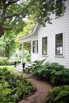 This would be a beautiful path on the side of our house. Charming White Farmhouse | Content in a Cottage