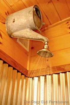 """Would be super cute for an outdoor shower, especially around a pool. A creative shower head using a watering can! Many other repurposed cabin decorating takes in this post too. -- Cozy Old """"Farmhouse"""": Cutest {Junkiest} Vintage Cabin. Cabine Vintage, Decorating Your Home, Diy Home Decor, Cabin Decorating, Decorating Stairs, Decor Room, Decorating Ideas, Diy Casa, Vintage Cabin"""