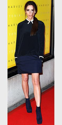 VICTORIA BECKHAM  To fete her line of dresses – called Victoria, Victoria Beckham – at London's Harvey Nichols department store, the star designer sports a schoolgirl-chic shift with ankle booties.