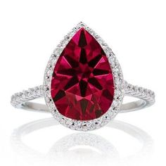 Pear Cut Ruby Halo Desiger Engagement for Woman. If you are looking for a Ruby gemstone engagement ring set at affordable prices then look no further than this beautiful Ruby and diamond wedding engagement ring. This ring can be customized to 10k 14k or 18k gold.