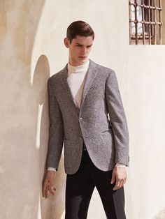 2-button #jacket in wool and silk frisé, melange grey, with optical black and white pattern, unlined with thin lapels, applied pockets. Turtleneck #sweater in extra-fine merino wool, optical white. #Trousers in sablé wool, black, without pleats, slant pockets, 19 cm base. #Corneliani #FW15