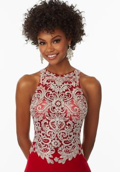 Morilee by Madeline Gardner 99075   Jersey Prom Dress with Beaded Embroided Back and Bodice. Embroidered Detail thoughout Skirt and Sweep Train. Side Slit. Zipper Back. Colors Available: Royal, Red.