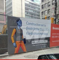 """The Bay Adelaide Centre in Toronto, Ontario is currently under construction -- but in an effort to alleviate public concern, building honchos posted a sign telling the locals, """"Construction set to finish faster than a Kim Kardashian marriage.""""  Read more: http://www.tmz.com/page/3/#ixzz2YT3kJFiP"""