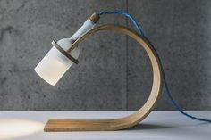 Integrating an exposed upcycled light source into reclaimed bent wood.  Innovative and green.