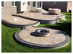 Beautiful multilevel interlock patio with a fire pit