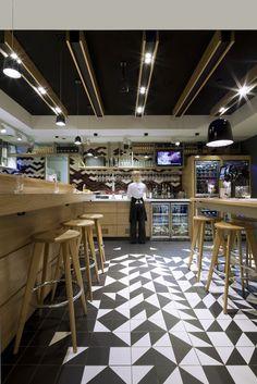 Restaurant interior design, Montreux Jazz Cafe (London), geometric black and white tile floor. NZ Architects - http://architecturehdt.co.nz/hospitality/