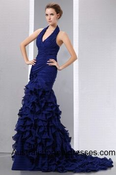 The breathtaking beauty of this dark blue long prom dress makes this lady look like a royal mermaid. The halter adds a touch of elegance along with the ruched deep V-line neckline, which looks sexy and attractive. The sleeveless and backless design goes perfectly well with the ruched layers, in the shadow of the luxury A-line floor length, which runs like the dancing sea wave.