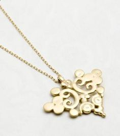 I am not sure why I like it, since I am allergic to all things gold or gold plated, or gold toned...but it is pretty.