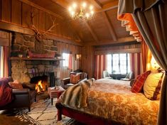 The Point Saranac Lake, New York Bedroom Cabin cozy extravagant fire Fireplace interior Lodge log cabin Luxury Rustic warm property building cottage home living room Suite farmhouse Villa