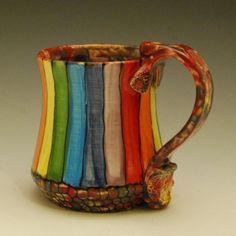 The fabulous colors of the rainbow adorn this handmade mug This mug will hold right around ounces if filled to the brim Made from soft earthenware clay wheel thrown and Pottery Mugs, Ceramic Pottery, Earthenware Clay, Cool Mugs, Ceramic Cups, Tea Mugs, Mug Cup, Sculpture, Rainbow Colors
