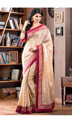 Get the diva look just like #Alia #Bhatt by draping this #Cream #2 #States inspired #saree. Made from #Satin, the saree is an #elegant piece of attire perfect for parties and events where you want to give yourself a complete ethnic and traditional look. The saree is embellished gracefully with fancy heavy lace patta work that adds more glam.