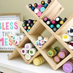 Wine rack turned paint rack -- what an ingenious storage idea from Find more clever craft organizing tricks in our bio link. Craft Organization, Organizing, Martha Stewart, Wine Rack, Clever, Parents, Storage, Holiday Decor, Frame
