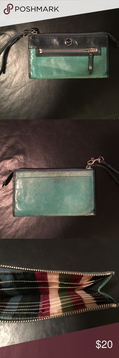 Coach Wristlet It's a very nice wristlet. Bit worn out. multi color stipe print inside and many pockets. Coach Bags Wallets