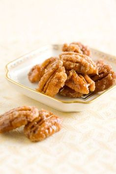 pecan praline morsels: 2 c. whole pecans, 1/2 c. packed lt. brown sugar   4 T. heavy cream ...  mix & spread on a spray-greased pan ... 350*  for about 20 mins, or until coating is dry and slightly crystallized, stirring once ... remove from oven to cool and stir once more ... if not serving immediately, store in an airtight container - paula deen