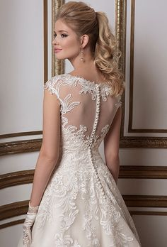 Brides: Justin Alexander. Soutache lace and tulle ball gown complemented with a Sabrina neckline.