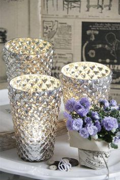 Jeanne D'arc Living Lovely glass for tea light candles made in poor mans silver. www.laurasliving.nl