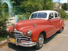 Old American car outside a home in Havana Cuba