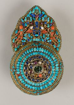 Crown Ornament for a Deity, Tibet, 17th - 19th Century. Gilt silver, emeralds, sapphires, rubies, garnets, pearls, lapis lazuli, coral, shell, and turquoise