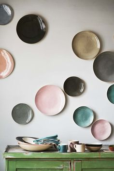 Who says wall art has to be on canvas or paper?  These arts-ily arranged plates make for a beautifully designed statement wall.