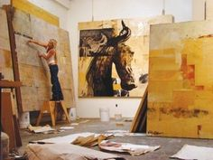"""Small woman huge art.  Love her studio -""""stable""""   - where she paints these fabulous horses."""