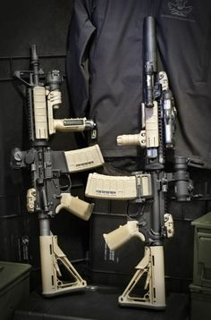 I want my future AR to look like the one on the left, I like that forward vertical grip. I don't like it when rifles are really decked out...