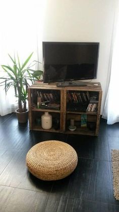 A media stand made from crates conveniently has space for your game consoles, cable boxes, and whatever else you need.   Source:  L'Art de la Caisse via Recyclart