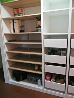 IKEA PAX units with Komplement drawers for a pantry.