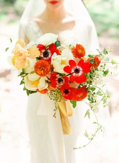 striking white, red and orange bouquet featuring peonies, roses, anemones and ranunculus by Full Aperture Floral