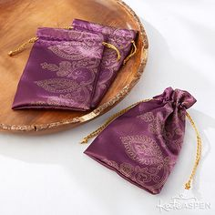 Pretty silky purple favor bags are perfect to fill with candies or other treats. The henna-inspired designs make them great for Indian or South Asian wedding events!
