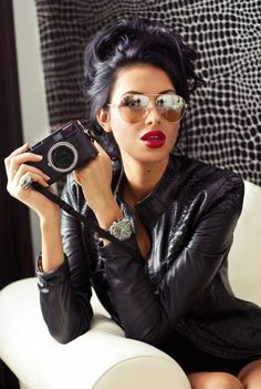 love everything about this picture!!!! Red lips, hair, sunglasses, watch, camera. gah...shes gorgeous!