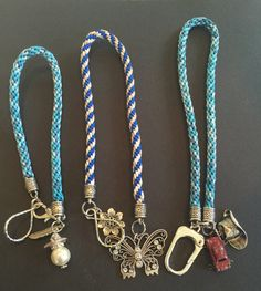 Kumihimo braided key chains with charms . They are extra long to loop around your wrist or use long easy to find !! Kumihimo is the ancient