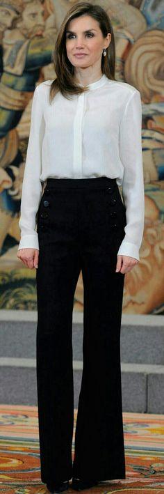Queen Letizia - Black 'Sandro' bell bottom high waisted pants. White Hugo Boss shirt - Nina Ricci pumps - Tous earrings