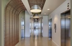 Lobby and/or Corridor/ Armstrong wood slat ceiling turning down to wall.