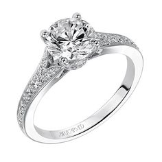 This diamond engagement ring features a split diamond shank. It's whimsical yet totally classic. #ArtCarvedBridal